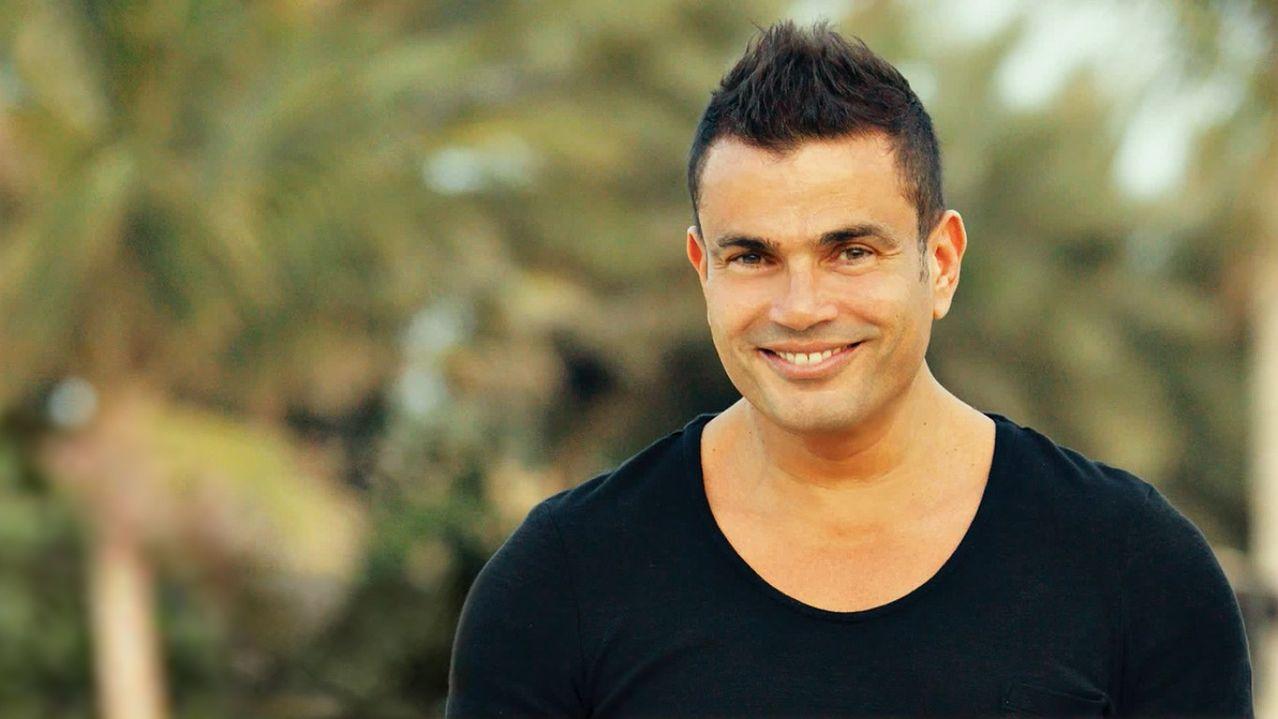 بالصور كلمات اغاني البوم عمرو دياب الجديد , معدى الناس 483 2