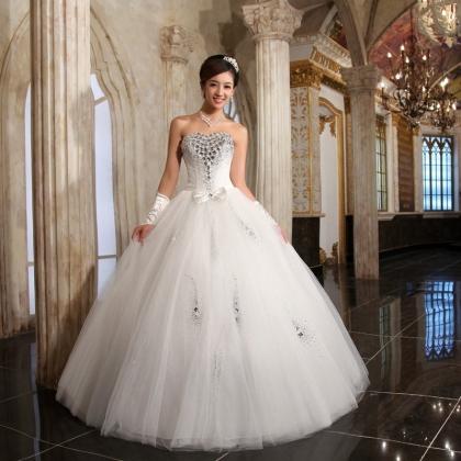 بالصور احدث تصميمات فساتين الافراح , تالقي يوم زفافك 137 9