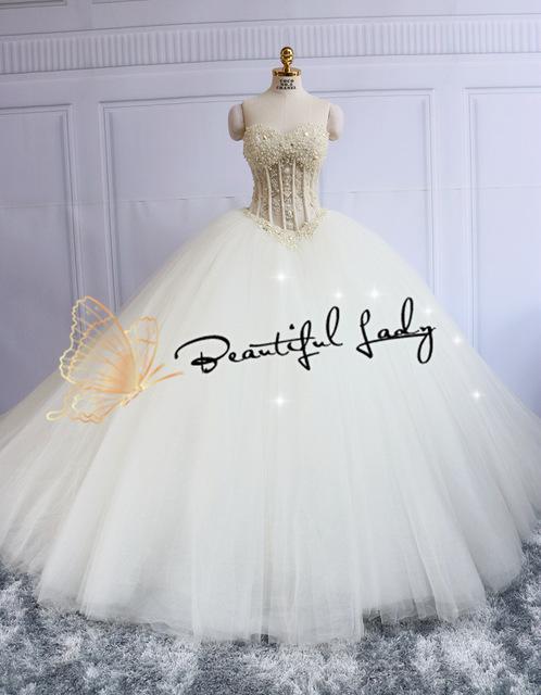بالصور صور فساتين زفاف مذهله , فستان عروسه رائع 3159