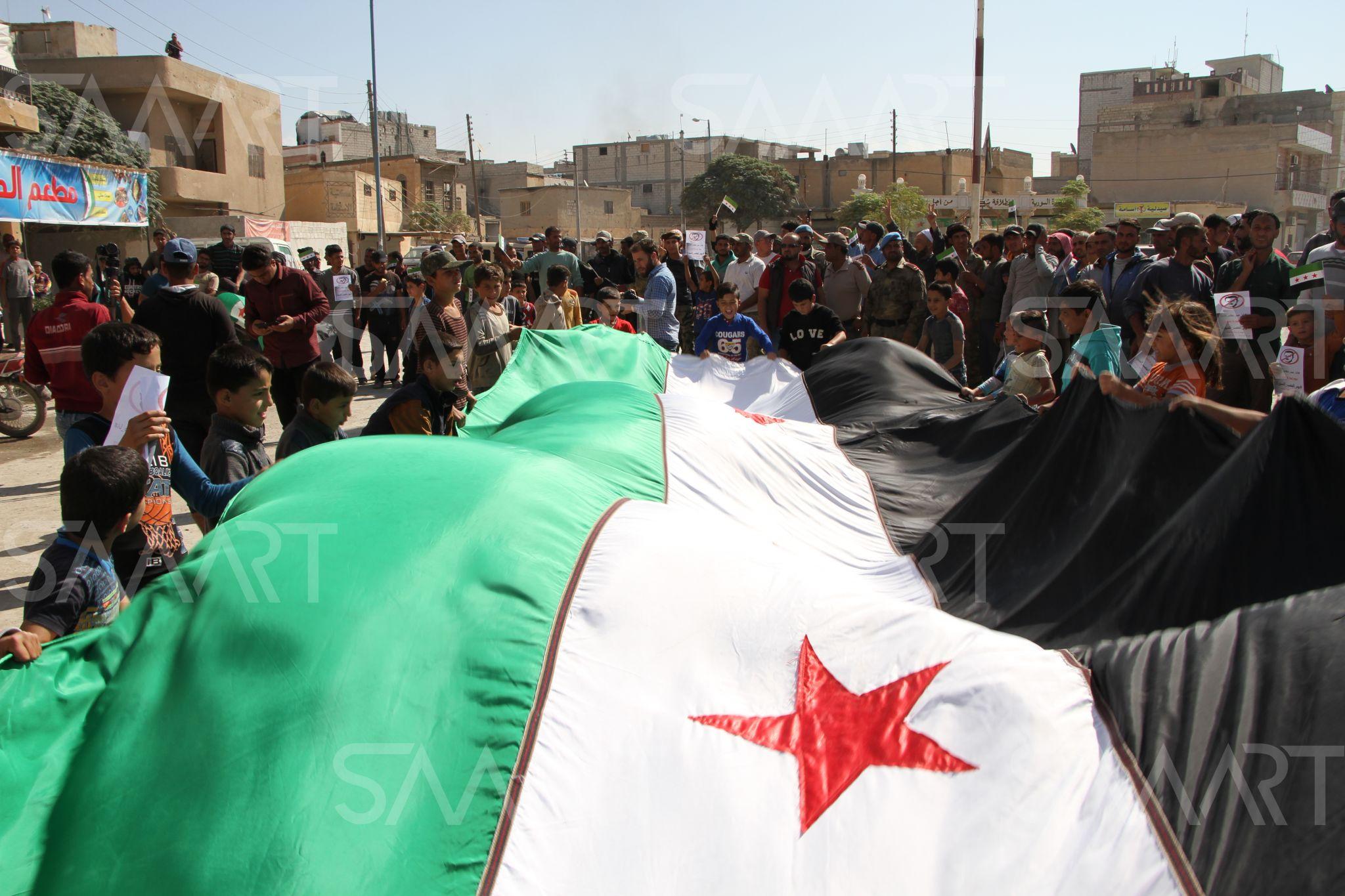 بالصور صور علم الثورة السورية , بوستات لرمز الانتفاضة 4077 9